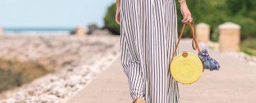 woman-summer-dress-walks-along-the-shore